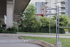 Basketball court in urban area. Dusk, dramatic view. Vancouver BC, Canada Stock Photo