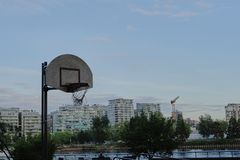 Basketball court in urban area. Dusk, dramatic view. Vancouver BC, Canada Royalty Free Stock Images