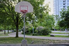 Basketball court in urban area. Dusk, dramatic view. Vancouver BC, Canada Royalty Free Stock Photo
