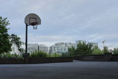 Basketball court in urban area. Dusk, dramatic view. Vancouver BC, Canada Royalty Free Stock Photos