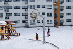 Basketball court winter small children nannies Royalty Free Stock Images