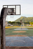 The Basketball courts. The weathered basketball courts with mountain Royalty Free Stock Photography