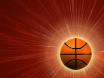Basketball with red rays. Basketball - 3d shining basket ball with lights and rays over red background Stock Photography