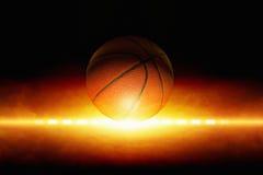 Basketball. Dark sports background - basketball, bright light from glowing horizon Royalty Free Stock Photos