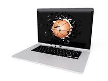 Basketball destroy laptop Royalty Free Stock Image