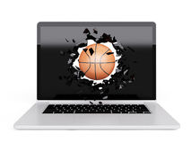 Basketball destroy laptop Royalty Free Stock Images