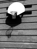 Basketball Dreams. Abandoned Basketball hoop in a shut down schoolyard stock photo
