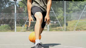 Basketball Dribbling through the legs stock footage