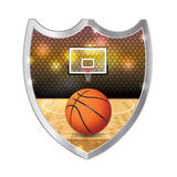 Basketball Emblem Illustration. An illustration of basketball sitting on a hardwood court with hoop and backboard inside an emblem. Vector EPS 10 available. EPS Royalty Free Stock Photos