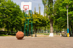 Basketball on Empty Basketball Court Stock Photos