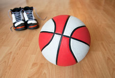 Basketball eqiupment. Basketball and pair of shoes Royalty Free Stock Image