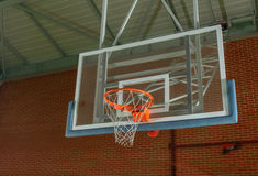 Basketball equipment on an indoor court Royalty Free Stock Photo