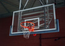 Basketball equipment on an indoor court Royalty Free Stock Image