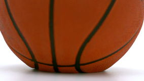 Basketball falling on the floor Royalty Free Stock Photo