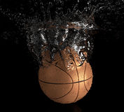 Basketball falls into water. 3d illustration Stock Photography