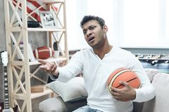 Basketball Fan with Upset Emotion Watching Game. Basketball Fan with Upset Emotion Watching Game with Basketball Ball in Hand. Leisure Concept. Watching Sport stock photos