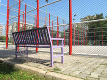 Basketball field and bench. An image of basketball field in  residential area Royalty Free Stock Photo