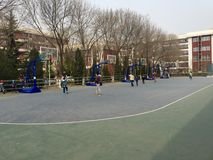 Basketball field. A basketball field in a community,people playing basketball Stock Image