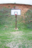 Basketball field covered with grass Royalty Free Stock Photos