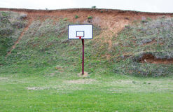 Basketball field covered with grass Royalty Free Stock Photo