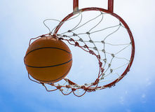 Basketball field goal with the sky. In background stock photo