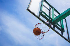 Basketball field goal with the sky. In background royalty free stock photo