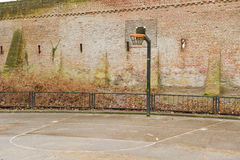 Basketball field near city defense wall. Basketball field near ancient city defence wall of Amersfoort, the Netherlands on january 24, 2014 Royalty Free Stock Images