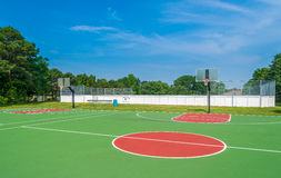 Basketball field. Outdoor basketball field at sunny day Royalty Free Stock Photo