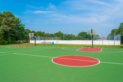 Basketball field. Outdoor basketball field at sunny day Royalty Free Stock Images