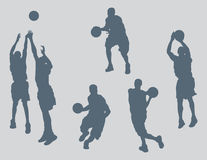 Basketball Figures Vector. Six basketball figures created in Adobe Illustrator.  These silhouettes are very detailed.  You will not be disappointed with the Royalty Free Stock Image
