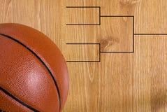 Basketball Final Four Bracket and Ball. A final four bracket on a basketball floor and a ball royalty free stock photo