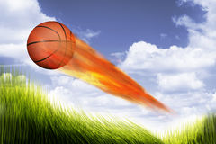 Basketball on Fire. Basketball on fire burning up the sky Stock Image
