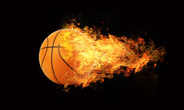 Basketball in flames Stock Photo