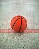 Basketball on floor Stock Images