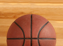 Basketball on floor of hard wood court. Close up of basketball on floor of hard wood court Stock Image