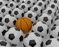 Basketball and football balls Stock Photos