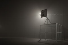 Basketball and football at night in the fog Royalty Free Stock Images