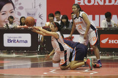 Basketball game between high school. Women's basketball player in action during a league match between middle school students in Solo, Central Java, Indonesia Stock Photo