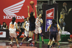 Basketball game between high school. Women's basketball player in action during a league match between middle school students in Solo, Central Java, Indonesia Stock Images