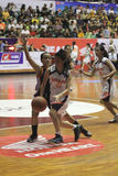 Basketball game between high school. Women's basketball player in action during a league match between middle school students in Solo, Central Java, Indonesia Royalty Free Stock Image