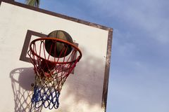 Basketball game outdoor equipment. Basket and ball. Accurate ball throw in basket. royalty free stock images