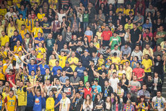 Basketball game - Supporters Cheering. Supporters cheering at a basketball game from the 2014 basketball playoffs between CSU Sibiu and U Mobitelco Cluj Stock Photos