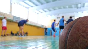 Teens train in the old sports hall. Basketball game. Teens train in the school old sports hall, throw the ball in the basket and run with the ball stock video