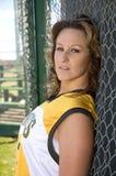 Basketball girl. Cute woman wearing a yellow basketball jersey Stock Photo