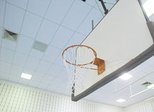 Basketball Goal. A basketball goal in a school gymnasium stock photo