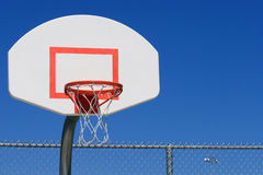 Basketball Goal. A city park basketball goal and blue sky royalty free stock photography