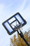 Basketball Goal 2. An outdoor basketball goal photographed against a cloudy blue sky royalty free stock photography