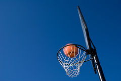 Basketball Goal. A basketball and goal waiting for a game to start stock photo
