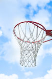 Basketball goal with blue sky and clouds. Basketball goal and net with blue sky and white clouds royalty free stock photos