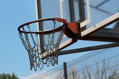 Basketball goal, Hoop and Net. On nice blue background, chains instead of ropes royalty free stock photo